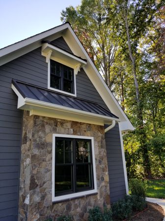 Courtland JamesHardie primed boardnbatten and plank siding customer had it painted standing seam metal roof