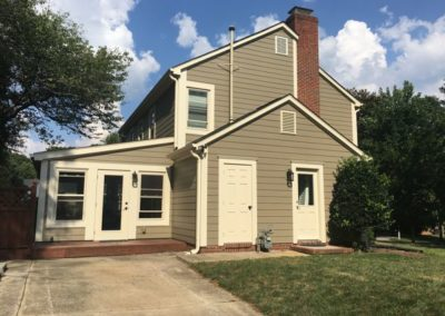 Schile Woodstock Brown with Navajo Beige trim back of house