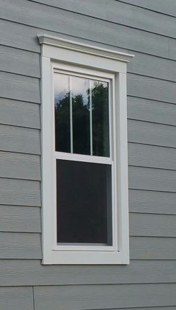 Vinyl windows cottage style with fams head crown JH trim